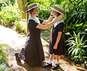 Why Glennie? - Senior Student arranging the hat of a Junior Student
