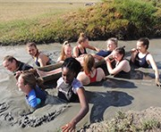 Group of Students having an activity in the mud